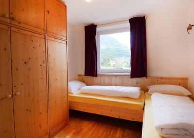 Melanies Guesthouse - Südtirol - Schlafzimmer mit 2 Einzelbetten