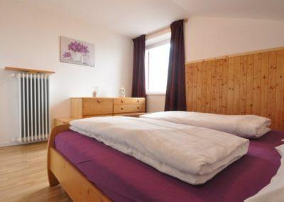 Melanies Guesthouse - Schlafzimmer mit Doppelbett